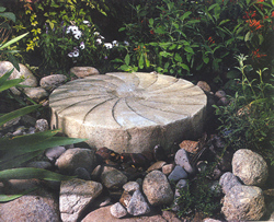Millstones in the Garden | Thinking Outside the Boxwood